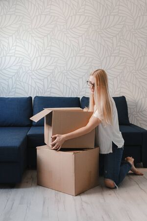 Photo of young blonde with cardboard box. 版權商用圖片