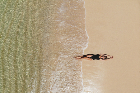 Aerial view of young woman on beach
