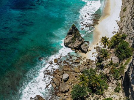 Aerial drone photo of tropical beach, sea rocks, turquoise ocean and palm trees. Atuh beach, Nusa Penida island, Bali, Indonesia. Tropical background and travel concept Imagens