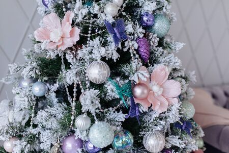 Christmas purple and silver decorations on the Christmas tree, snowflakes balls garlands, closeup texture background