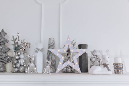 Christmas and New Year decorated white interior room with presents and New year tree and fireplace Stock Photo