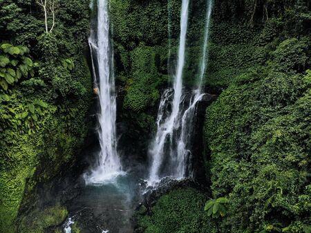 Aerial view of Sekumpul waterfall on Bali island Indonesia - travel and nature background. Drone photo.