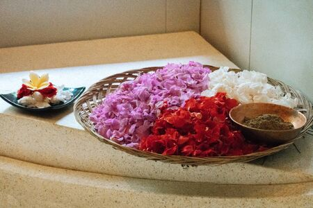 Violet, red and white petals in silver bowl on stone background. Details for bath. Spa,organic and skin care, beauty treatment concept 版權商用圖片