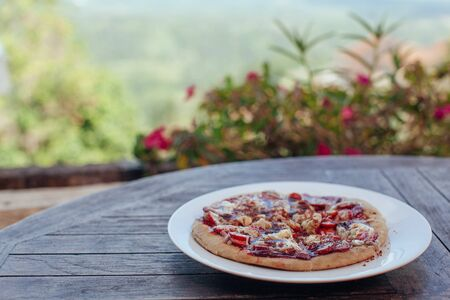 Incredibly delicious strawberry pizza . Pizza with strawberries . Original pizza with cheese and strawberries on wooden table