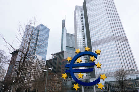 FRANKFURT-AM-MAIN, GERMANY - MARCH 2020: buildings of the European Central Bank and Euro sign in rainy fog weather in spring Редакционное