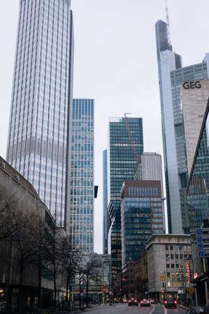 FRANKFURT-AM-MAIN, GERMANY - MARCH 2020: Skyscrapers in financial district in fog rainy day. Skyline of big modern city.