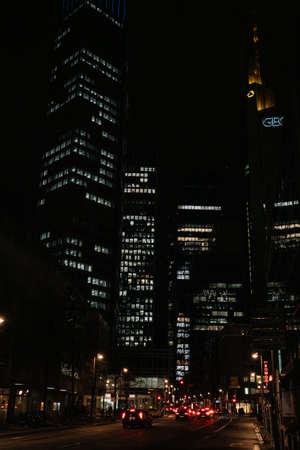 FRANKFURT-AM-MAIN, GERMANY - MARCH 2020: Nighttime skyline of a big modern city at night. Skyscraper at lights in financial district Редакционное