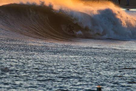 Surfing big waves in Santa Barbara Harbor