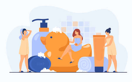 Women wrapped in towels using sponge and soap among bath accessories, tubes and shampoo bottles. Vector illustration for bathroom, spa, routine, hygiene concept