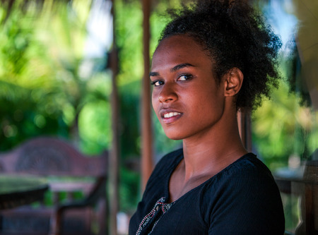 Melanesian pacific islander, beautiful girl with afro, half profile Stock Photo - 93287112