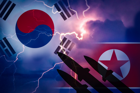 Silhouette of missiles against the background of the flag of North Korea and the flag of South Korea and lightning in the background. Symbolizes the aggression of North Korea to South Korea.