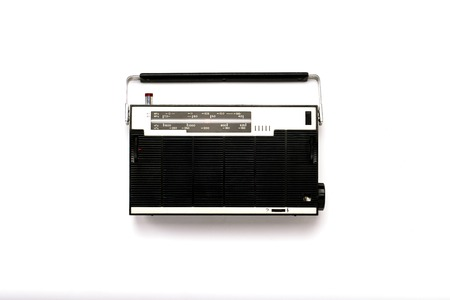Retro radio receiver on white isolated background. Flat lay, top view.