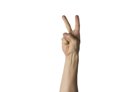 Male hand with two fingers raised on a white background. Side picture. Peace gesture, greeting.