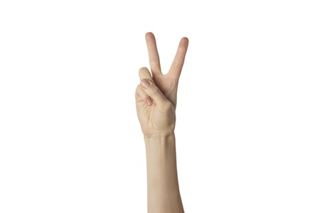 Female hand raised up and showing a gesture of peace with two lifted fingers on a white background. Gesture Yo. Concept of power, unity, rap respect.