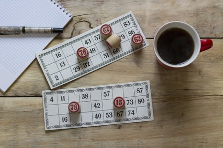 Bingo. Cup with coffee. Notepad and pen. Stock Photo