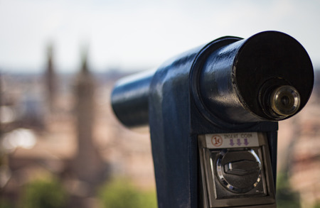 Panoramic telescope. In the background, the Italian city is out of focus