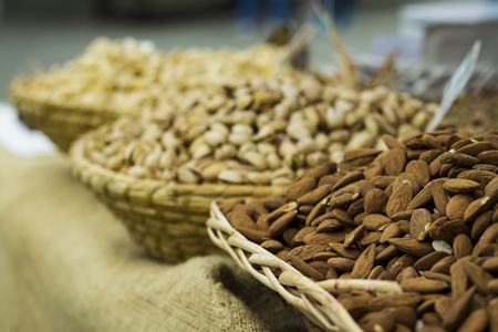 Picture of nuts in baskets. Back background out of focus