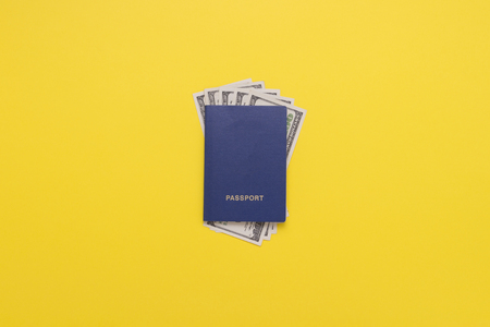 Passports and Banknotes of dollars on the Yellow background. Minimalist style. The concept of Travel and Holidays. Flat lay, top view.