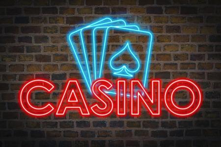 Enseigne lumineuse au néon avec texte Casino et quatre cartes à jouer sur le fond d'un mur en céramique.