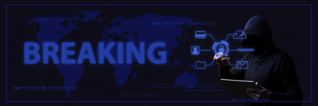 The concept of hacking and hacker attacks with a faceless man in a hood and blue lighting. Added text Breaking .