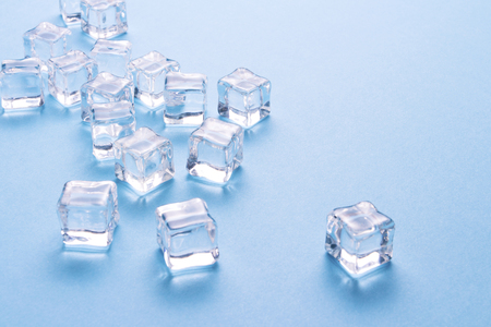 Ice cubes on a light blue background.