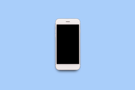 White mobile phone on a blue background. Flat lay, top view.