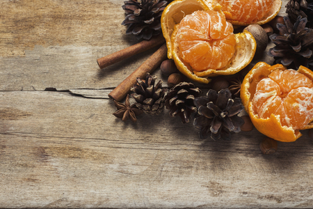 Tangerines, cones, spices on a wooden background. Сoncept of New Year and Christmas, Christmas drink Mulled wine. Flat lay, top view