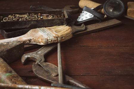 Vintage Working Tool on a Dark Wooden Background. Father's Day Concept.