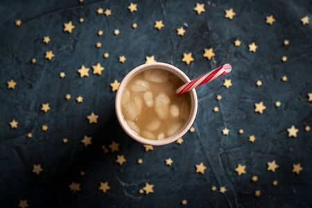 Coffee with ice and milk in a glass on a dark blue stone background with stars. Concept cooling drink, thirst, summer, starry sky, nightlife, insomnia. Flat lay, top view. 写真素材 - 124719828