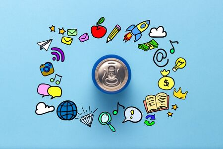 Tin can with a drink on a blue background with icons. minimalism. Concept of day and night, caffeine, energy drink, fun, holiday. Flat lay, top view 写真素材
