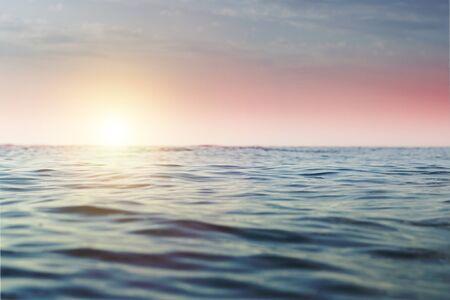 Sea at sunset and at sunrise. Seascape. Narrow focus.