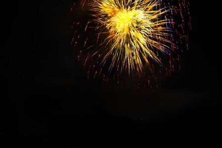 Awesome isolated Festive fireworks on a dark background. Can be used as wallpaper or background. 写真素材