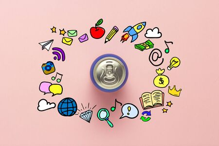 Tin can with a drink on a pink background with icons. minimalism. Concept day and night, caffeine, energy drink, funny icons. Flat lay, top view