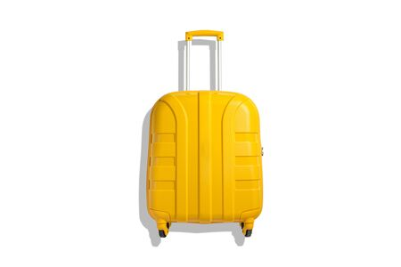 Yellow suitcase on a white background. Travel and vacation concept. Flat lay, top view. Фото со стока