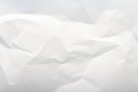 Crumpled white paper. Texture. Can be used as background or wallpaper. Flat lay, top view.