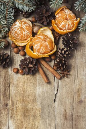 Tangerines, Christmas tree branches, cones, spices on a wooden background. Concept of New Year and Christmas, Christmas drink Mulled wine. Flat lay, top view Stock fotó