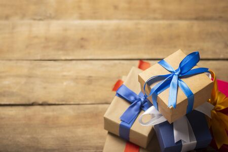 Stack of gifts on a wooden background. Holiday concept, christmas, christmas eve. Flat lay, top view.
