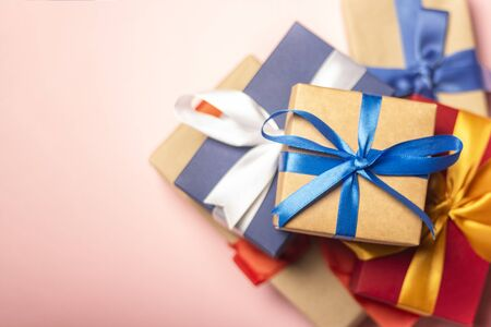 Stack of gifts on a pink background. Gift concept for a loved one, holiday, Christmas. Flat lay, top view. Banco de Imagens - 133462411