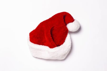Santa Claus hat on a white background. Christmas concept, holiday. Isolate Flat lay, top view. Banco de Imagens - 133462416