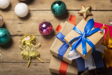 Stack of gifts, Christmas-tree decorations on a wooden background. Holiday concept, christmas, christmas eve. Flat lay, top view. Banco de Imagens - 133462413