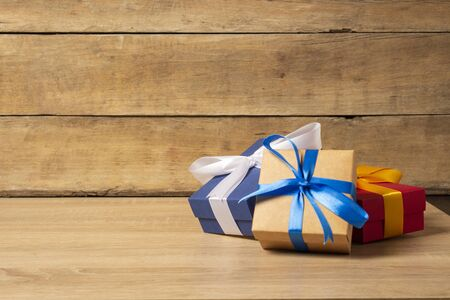 Gifts on a wooden background. Holiday concept, christmas. Banco de Imagens - 133462420