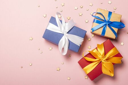 Gift boxes on a pink background with stars. Gift concept for a loved one, holiday, Christmas. Flat lay, top view. Banco de Imagens - 133462459