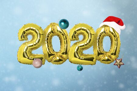 Figures 2020 air balloons flying and Christmas decorations on a blue background. New Year concept, celebration.