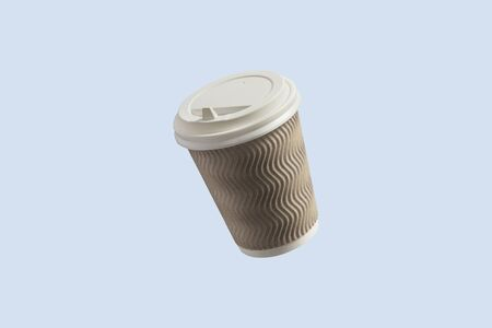 Paper cup with coffee flying in the air on a light blue background. Coffee shop concept. Levitation. Banco de Imagens