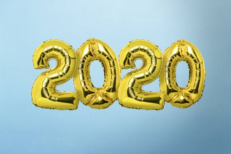 Air balloons numbers 2020 fly on a blue background. New Year concept, celebration.