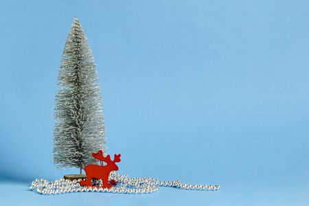 Decorative christmas tree and decorations on a blue background. The concept of the winter holidays, Christmas, New Year. Banner.
