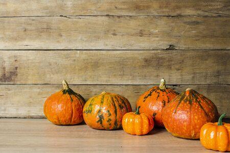 Pumpkins on a wooden background. Halloween concept, harvest, halloween eve.