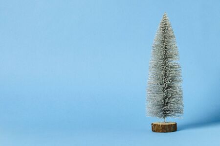 Decorative christmas tree on a blue background. Winter holidays concept, christmas, new year.