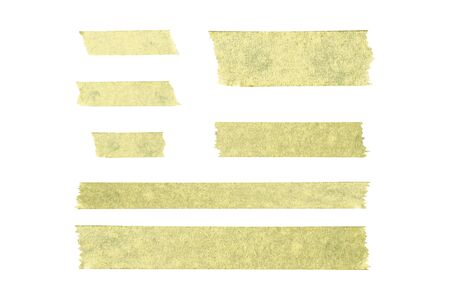 Torn pieces of paper tape on a white isolated background. Flat lay, top view.