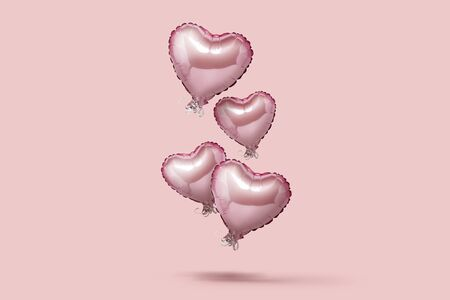 Flying pink air balloon in the shape of a heart on a pink background. Love concept, valentines day. Banner. Flat lay, top view.